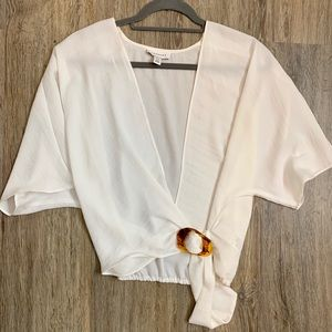 White blouse with open V neck line
